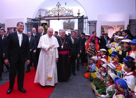"Handout photo released by the Ecuadorean Presidency of Pope Francis next to Quito's Archbishop Fausto Travez (C-R) and Ecuadorean President Rafael Correa (L) as he visits Carondelet Presidential Palace in Quito on July 6, 2015. Earlier in the day, the first pope from Latin America made an impassioned plea to fulfill the ""social debt"" toward families as he addressed some 800,000 people in a park in Guayaquil, Ecuador's largest city, according to official figures. AFP PHOTO / ECUADOREAN PRESIDENCY"