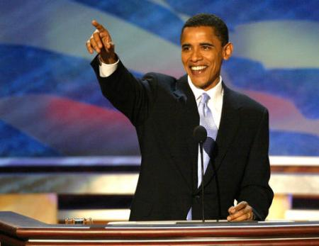 """Barack Obama, the 42-year-old state senator from Illinois, gives his keynote speech during the second session of the DNC. """"In this election, we are called to reaffirm our values and commitments, to hold them against a hard reality and see how we are measuring up to the legacy of our forebears,"""" he said. """"And fellow Americans ... we have more work to do."""""""